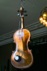 A tactile transducer violin ceiling