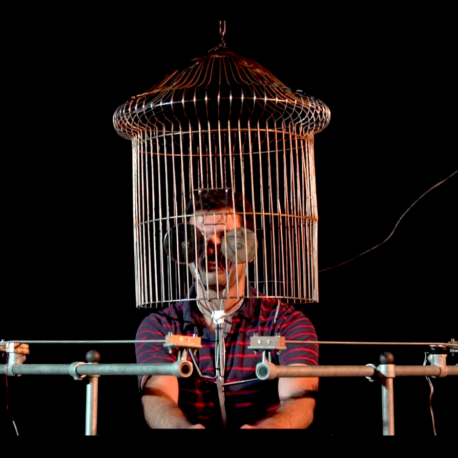 Erfan Abdi in the bird cage, performing Points of Contact at STEIM.