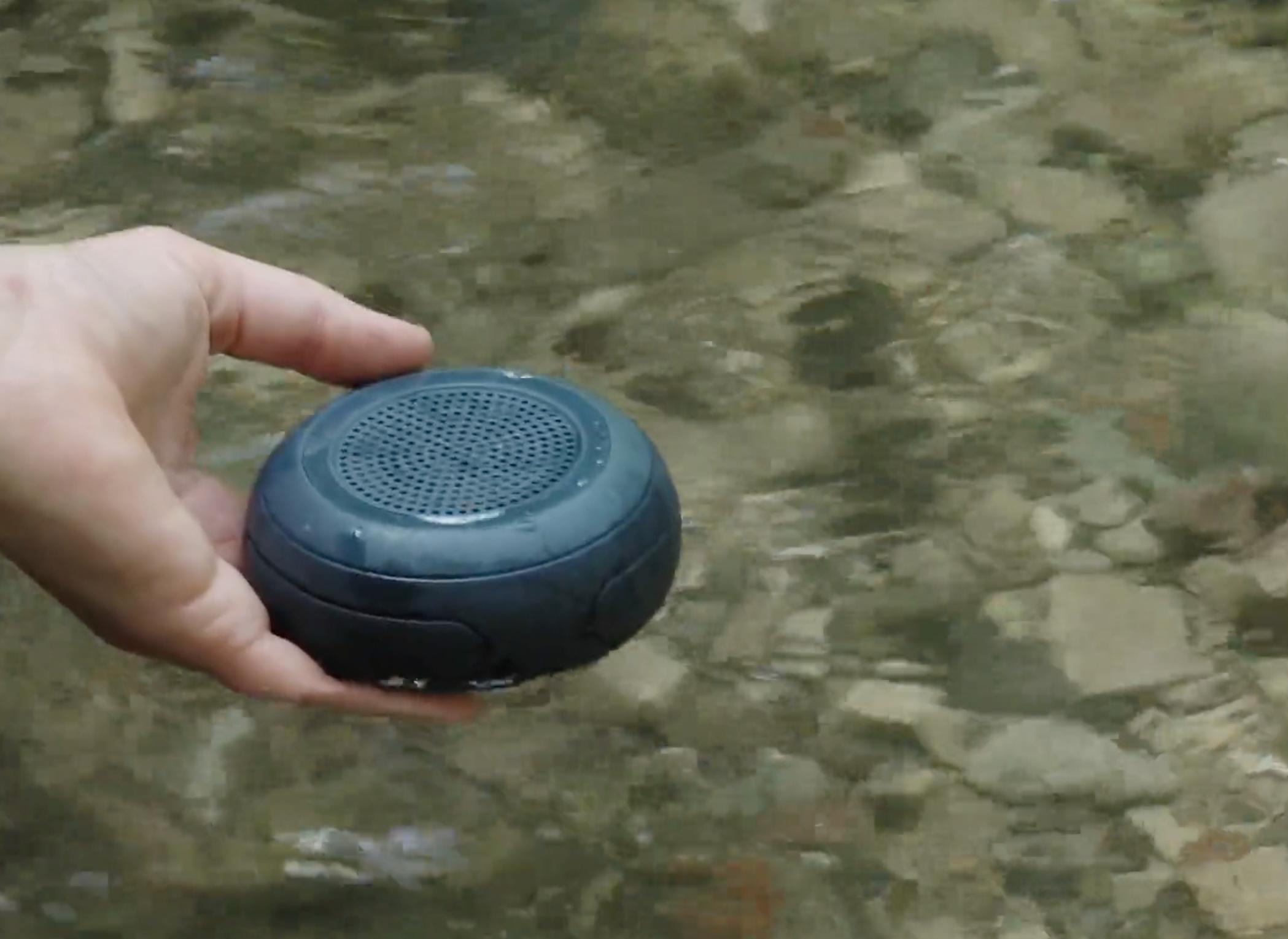 floating waterproof loudspeaker placed in the river